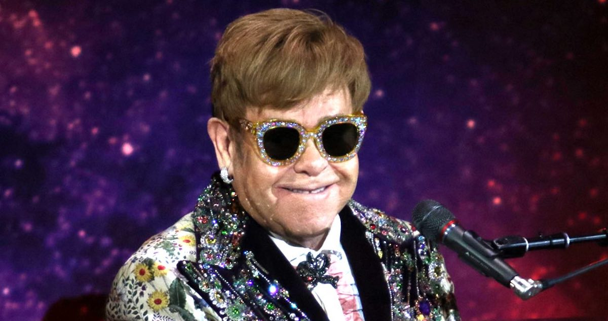 What are Elton John's hits about?